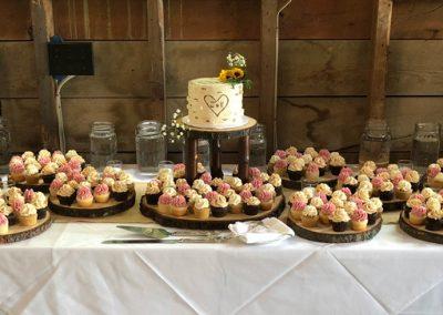 cutting cake and mini cupcakes
