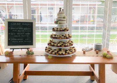 seminaked cake and mini cupcakes display