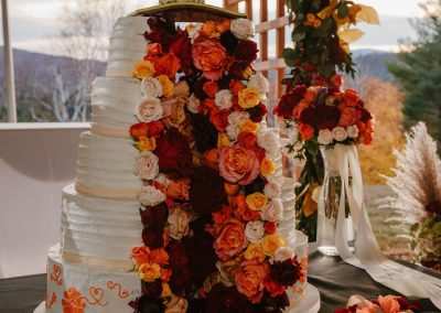 vegan 5-tier split wedding cake filled with flowers